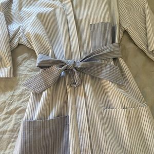 in pristine condition a never worn shirt dress